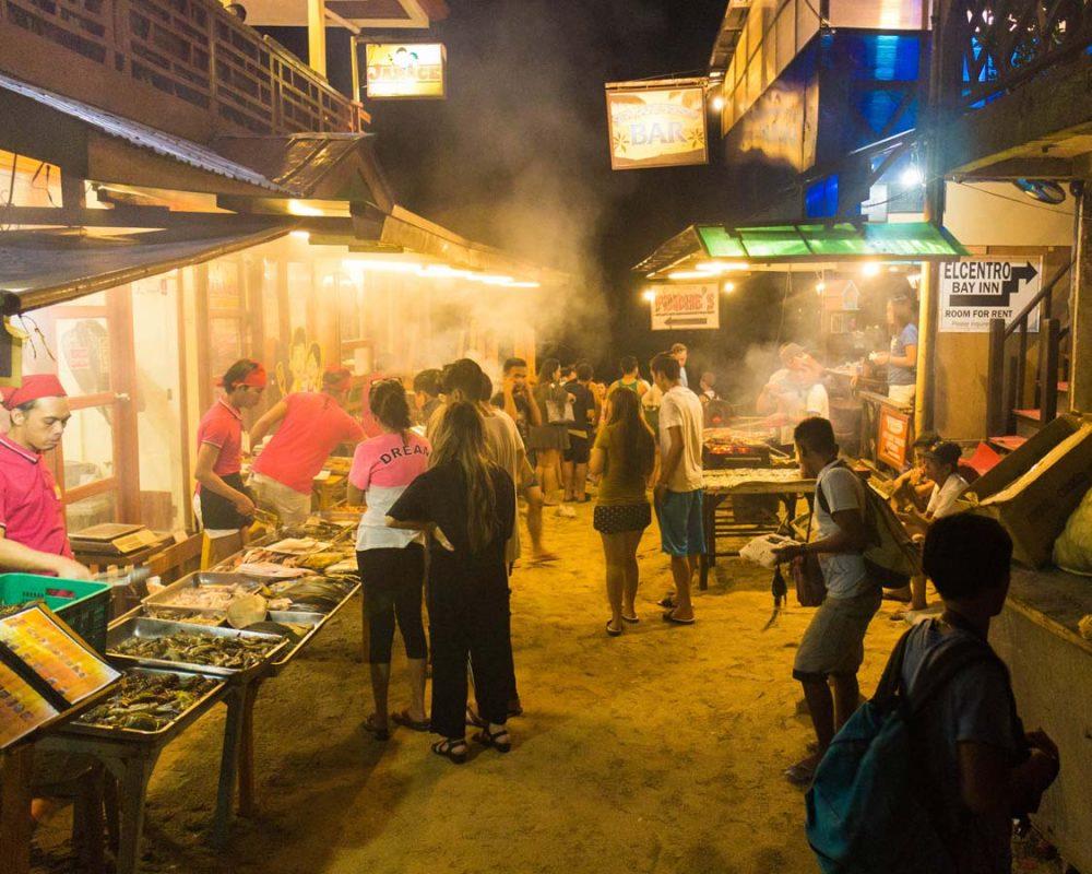 Market selling Filipino pork bbq in El Nido, Philippines